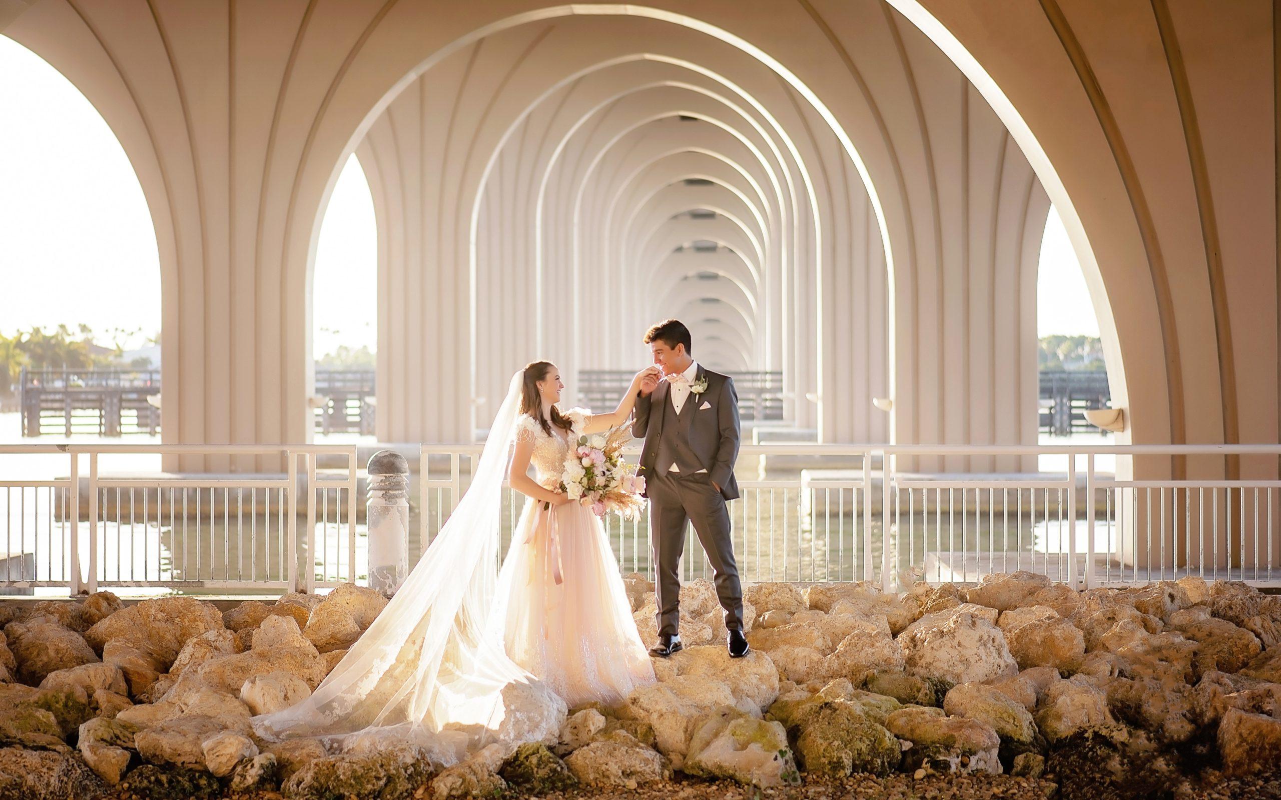 tampa wedding photography, Isla del sol, bride and groom under a bridge